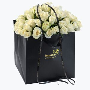 White Roses in a giftbag